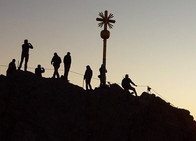 Group on top of mountain, silhouette